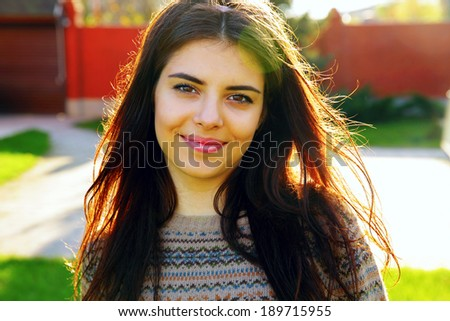 Portrait of a young smiling beautiful woman - stock photo