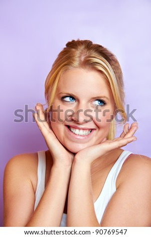 portrait of a young smiling blond woman is smiling - stock photo