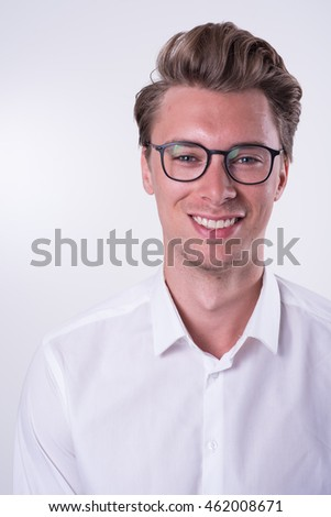 Portrait of a young smiling business man in white shirt