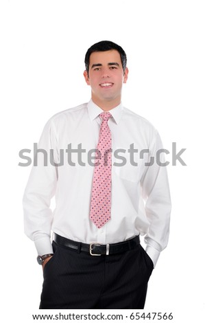 Portrait of a young smiling businessman in a white shirt with hands in pockets - stock photo