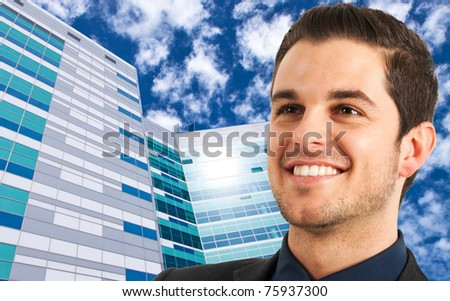 Portrait of a young smiling businessman. Skyscrapers in the background. - stock photo