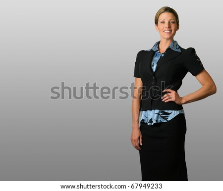 Portrait of a young smiling businesswoman standing against neutral background with lots of copy space - stock photo