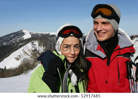 Portrait of a young smiling couple in the mountain