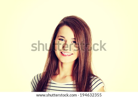 Portrait of a young smiling female caucasian teen. - stock photo