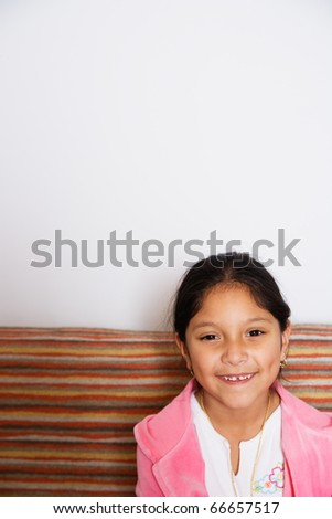 Portrait of a young smiling girl - stock photo
