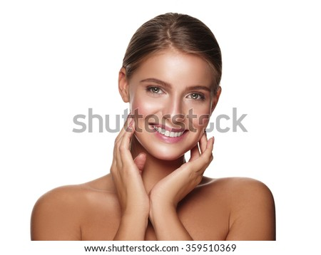 Portrait of a young smiling healthy and beautiful girl with nude make up