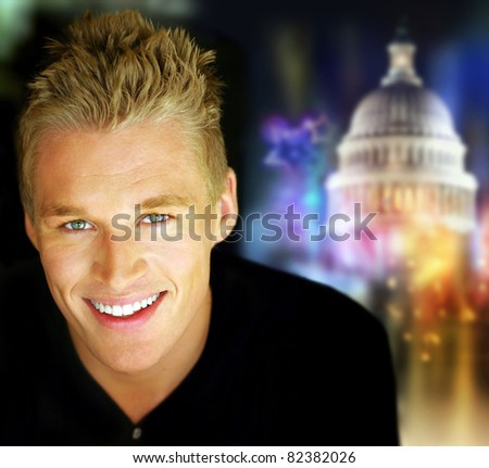 Portrait of a young smiling man against abstract political festive background
