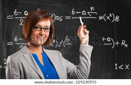 Portrait of a young smiling teacher - stock photo