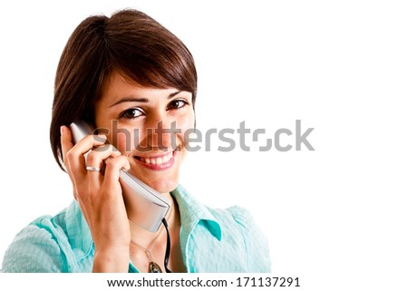 Portrait of a young smiling woman using a telephone - stock photo