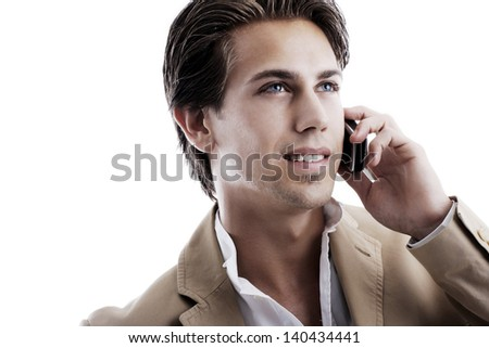 Portrait of a young sophisticated businessman talking on a mobile phone on a white background - stock photo