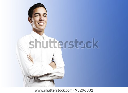 portrait of a young student smiling with shirt against a blue background - stock photo