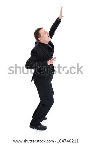 Portrait of a young successful businessman celebrating with his arms pointing up