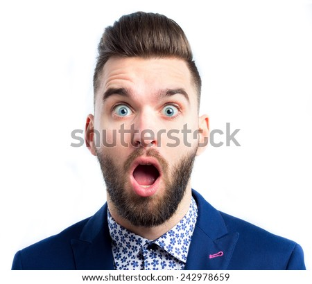 Portrait of a young surprised businessman with opened mouth - stock photo