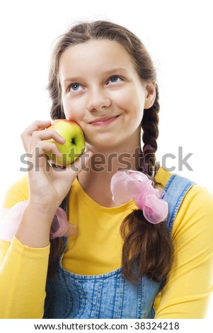 Portrait of a young teenager girl with apple standing and smile,isolated on white - stock photo
