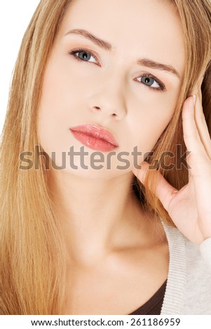 Portrait of a young thoughtful woman. - stock photo