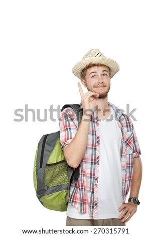 portrait of a young traveling man with backpack pointing up isolated on white background - stock photo
