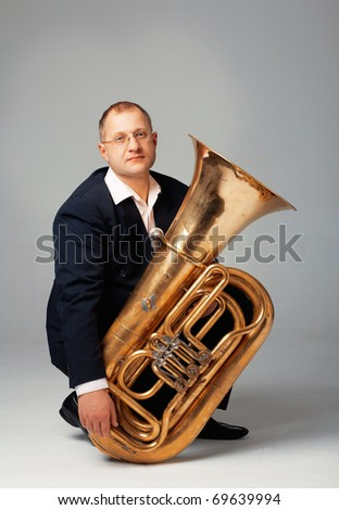 Portrait  of a young tubaist with his instrument - stock photo