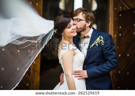 Portrait of a young wedding couple on their wedding day - stock photo