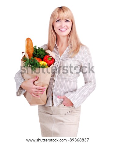 Portrait of a young woman after shopping with a bag with food