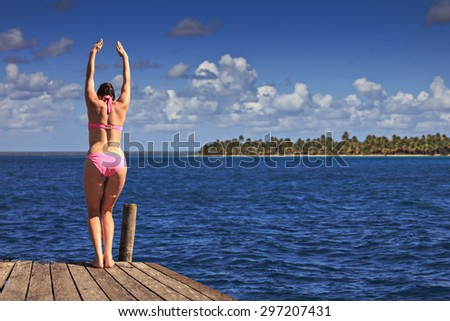 portrait of a young woman at seaside - stock photo