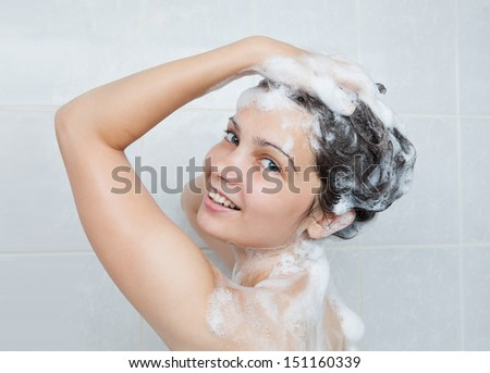 Portrait of a young woman bathing in bathroom