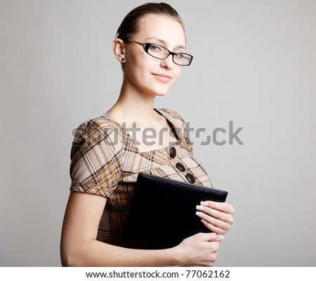 Portrait of a young woman, college student or teacher
