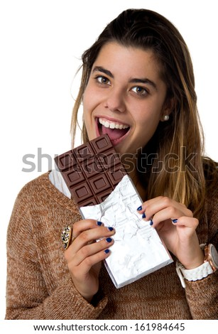 portrait of a young woman eating chocolate isolated on white - stock photo