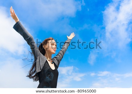 portrait of a young woman enjoying a freedom - stock photo