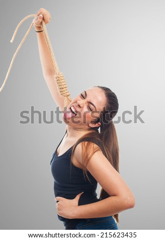 portrait of a young woman hanging with a rope - stock photo
