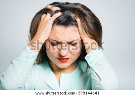 Portrait of a young woman has a headache, migraine, closeup - stock photo