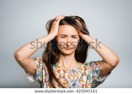 Portrait of a young woman has a headache, migraine, closeup - stock photo
