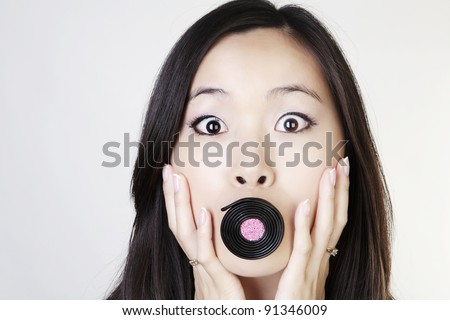 portrait of a young woman having fun with liquorice