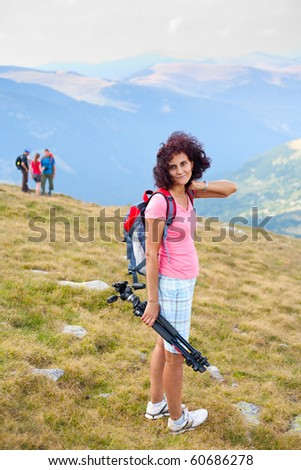 Portrait of a young woman hiking in mountains - stock photo