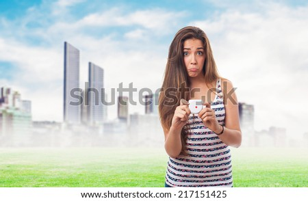 portrait of a young woman holding a dice - stock photo