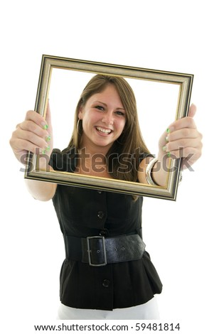 Portrait of a young woman holding a frame around her face isolated on white
