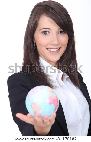 Portrait of a young woman holding a globe - stock photo