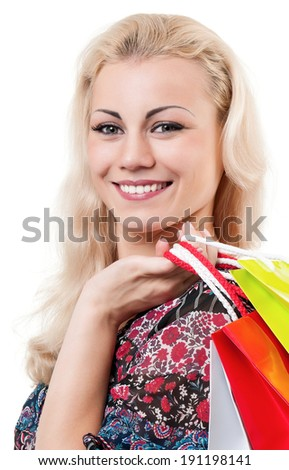 Portrait of a young woman holding a shopping bags over white background - stock photo