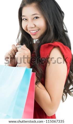 Portrait of a young woman holding shopping bags - stock photo