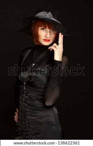 Portrait of a young woman in a black hat