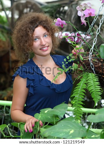 portrait of a young woman in a tropical garden - stock photo