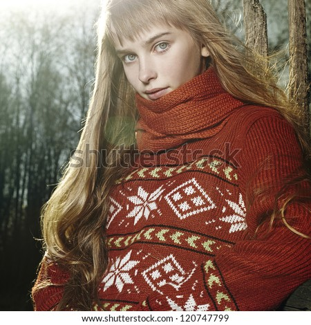 portrait of a young woman in a wool sweater in nature, spring autumn fashion - stock photo