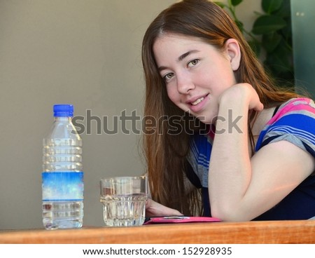 Portrait of a young woman in Crete, Greece - Happy teenage girl enjoying the summer vacation on the Greek island of Crete - stock photo