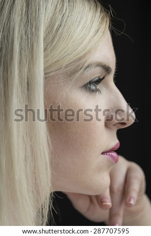 Portrait of a young woman in deep thought - stock photo