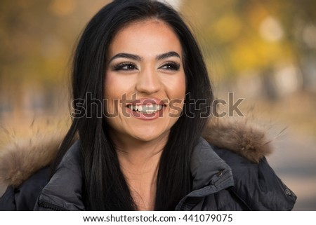 Portrait Of A Young Woman In Forest During Autumn