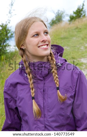 Portrait of a young woman in outdoor jacket - stock photo