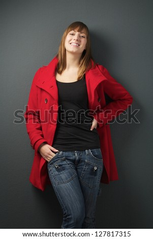 Portrait of a young woman in red jacket - stock photo