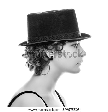 Portrait of a young woman in retro hat in profile. - stock photo