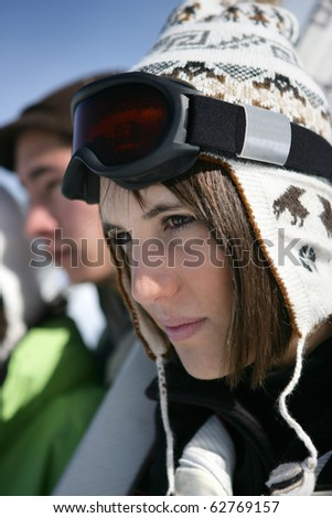 Portrait of a young woman in snowsuit - stock photo