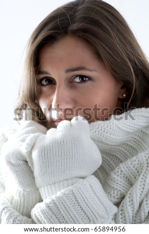 Portrait of a young woman in soft white sweater