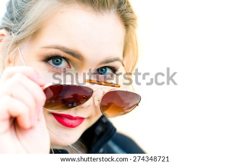 Portrait of a young woman in sunglasses close-up in high key, shallow depth of field - stock photo